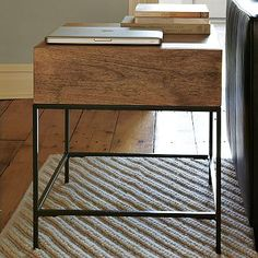 I love the Rustic Storage Side Table on westelm.com. Two of these might be great in place of a traditional coffee table.