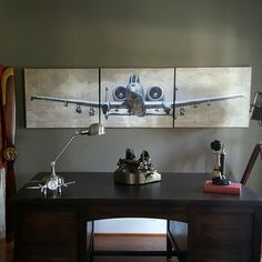 """The newest airplane in our popular wood aviation triptych series features the A-10 """"warthog"""", an attack plane that featured prominently as a prime tank destroyer in the Gulf war and in many military actions before and since.    Its difficult to show just how impressive this piece is, as weve printed with fade resistant inks in a vintage antiqued sepia tone on the rough cut side of three thick (3/4"""" inch) solid wood panels. No two are exactly alike, but all feature unique features such as…"""
