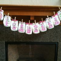 diapers spelling out baby's name