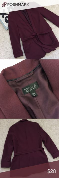 TOPSHOP Deep Berry Girlfriend Blazer Jacket This is a size 6 deep berry color. tie waist blazer. the blazer is fully lined and features cuffed sleeves. this jacket is very well tailored. You can easily dress this blazer are up or down. Excellent Used Condition. No obvious marks, defects or flaws Topshop Jackets & Coats Blazers