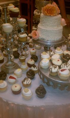 Wedding display with lots of fun gourmet cupcake flavors!