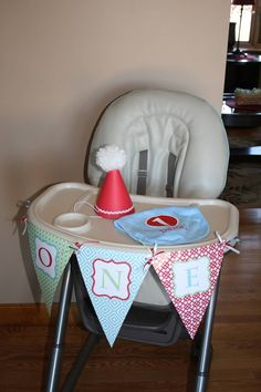 """DIY with Photoshop: """"ONE"""" banner for 1st birthday party.  Color schemes: red, light blue and green.   DIY party hat.    Bib ordered online from fly duds."""