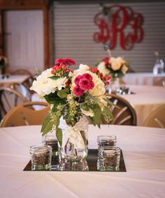 Mason jars on guest tables - Hydrangeas, roses, hypericum berries and purple mums with seeded eucalyptus. Natural Wonders Photography | Flic...