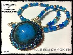 Short necklace with blue/turquoise agate beads. Cabuchonen I have made in resin, which I then included with Czech beads into a pendant. All is my own design.   www.facebook.com/illdebasmycken