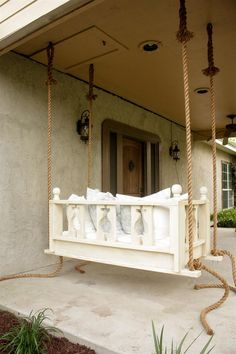 Porch swinging just got a little sweeter! This simple elegant swing will spruce up any porch just in time for summer! The plans are centered around using a crib mattress as the cushion, so grab a crib sheet and some pillows and you have a cozy bed swing to relax in all year long! Get the free DIY plans from @buildcraftlove at buildsomething.com