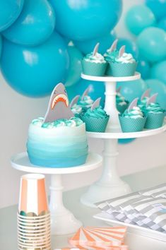 Shark cake and cupcakes baby shark party in 2019 shark party, birthday part Birthday Party Desserts, Boy Birthday Parties, Birthday Ideas, Baby First Birthday Cake, 2nd Birthday, Happy Birthday, Shark Cake, Shark Party, Ocean Party