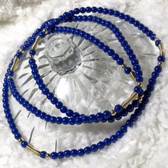 Long Blue/Gold Beaded Necklace Beautiful cobalt blue beads with gold accents. Necklace is nice and long to go great with sweaters. Screw hook.  ✅ Bundle and save on shipping! ✅ All reasonable offers are considered.  ✅ I always ship right away.  ❌ PayPal ❌ Trades ❌ Lowballing Jewelry Necklaces
