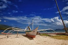 Boat in midday sun by HeikkiA, via Flickr  Palawan, Philippines, 1 hour by boat to nearest road