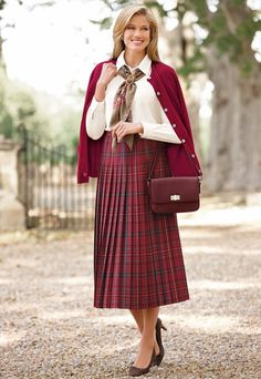 Red plaid accordion pleated skirt with matching sweater and pocketbook and white blouse.