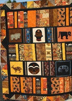 African inspired Quilt I\'m looking for inspiration for Tyler\'s African quilt which I am making out of the fabric from shirts he had made in Africa and no longer wears. I want big blocks to show off the big motifs in his shirts.