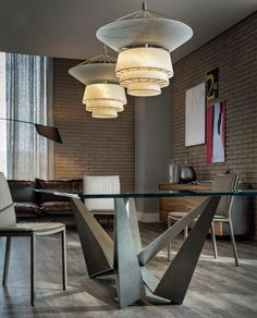 Bolero by Cattelan Italia is a suspension lamp with an oriental design. The light metal structure is here matched to the elegance of the fabric lampshade to create a unique element of furniture, with an elegant and extremely refined effect.