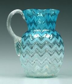 Art glass pitcher, blue to clear, alternating shaded and clear herringbone design, reeded handle, in.