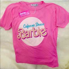 *FLASH SALE! Wildfox NWT scented pink Barbie Top Suldfox Barbie scented top!! So cute! So soft and comfortable this is a celeb fav! LAST ONE! On sale! Discounts available please ask!:) or $76 on m w free shipping! Wildfox Tops Tees - Short Sleeve
