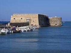 Venetian fortress Koules in Heraklion city at Crete island in Gr - Stock , Crete Island, Greece Islands, Heraklion, Wordpress Theme Design, Fortification, Birds In Flight, Venetian, Tourism, Scenery