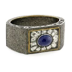 sapphire cabachon wide cuff This simply stunning bangle is embelished with over 26ct of pave and antique-cut diamnonds.