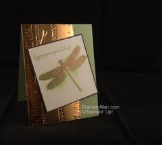 This card started when I wanted to play with this set and watercolor paper. I stamped the solid dragonfly wings & body on watercolor paper, then I spritzed it with water so the ink would bleed. A quick shot of the heat tool, and it was ready for the detailed dragonfly to be embossed in copper.  When I started to add the strip of copper foil paper, I realized it needed something. A quick trip through the Big Shot with the Woodlands embossing folder did the trick.