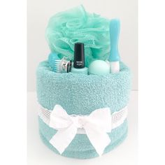 Want to be the giver of the most UNIQUE, USEFUL, and BEAUTIFUL gift for a special girl / woman in your life!? Youve come to the right place! Our cakes can be custom made to match ANY color scheme imaginable! Our 1 Tier Beauty Towel Cake Includes: 2 Soft Bath Towels 1 Nail Polish