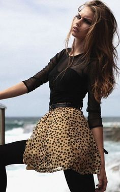 I love this top and I love this leopard skirt. What would top this outfit off is some red high heels w/ red lipstick =)