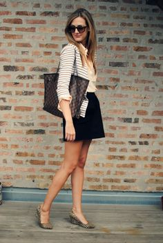 Black pencil skirt, silk button-down, striped cardigan, animal-print pumps.