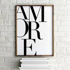 Italian poster print in black and white reading AMORE. A modern typographic print, featuring the Italian word for love. Amore. Professionally produced archival quality print with a soft matte finish.