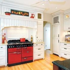 It's all about the red Aga range in this 1920's kitchen redo. | Photo: Janis Nicolay | thisoldhouse.com