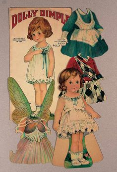 """American Paper Doll """"Dolly Dolly"""" by Hubbell-Leavens  12"""". Featuring a single-side easel-back cardboard doll with three costumes including unusual winged disguise and Scottish costume,along with original envelope showing doll in Scottish costume,and a book cover for Dolly Dimple. Envelope worn,doll and costumes excellent. Hubbell-Leavens 1920's series."""