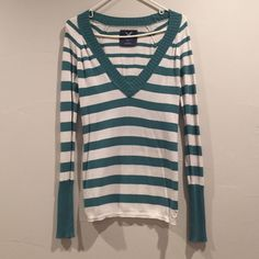 American Eagle Long Sleeve Shirt Super cute stripped shirt that's perfect for fall! Can be dressed up or down and looks great with skinny jeans! In good condition. American Eagle Outfitters Tops