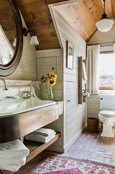 Simple Fresh Rustic Bathroom With Brick Floor, Shiplap Walls, Farm Sink And Wood Ceiling