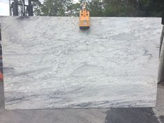 River white premium granite white and grey veining with small deep burgundy flecks.