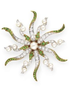 AN ANTIQUE DIAMOND, DEMANTOID GARNET AND PEARL BROOCH. Centring upon a pearl pistil, extending old European-cut diamond and circular-cut demantoid garnet petals with pearl accents, mounted in platinum-topped gold, circa 1890, with maker's mark. #antique #brooch