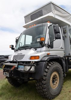 Unimog camper with pop-top!  Cult status in Germany.  Made by Mercedes Benz.