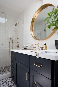 So totally in love with this cute little number by Kirsten Marie Interiors! The tile. The cabinet color. The mirror. Seriously love every little thing! image