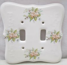http://www.ebay.com/itm/Vintage-TH-Athena-USA-Porcelain-Double-Light-Switch-Plate-Cover-White-Flowers-/401100233610?hash=item5d636fdb8a:g:UxUAAOSw6wRXAXHo