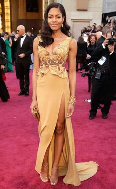 Oscars 2017: My First Academy Awards: See The Ultimate Throwback Photos       NAOMIE HARRIS, 2013:    Instead of opting for a custom designer gown for her first Oscars appearance, the Moonlight actress wore the winning design from the  Suzy Amis Cameron's Red Carpet Green Dress challenge. Created by a Ghana‐born fashion student who was mentored by Vivienne  Westwood, the dress was made with organic, recycled and natural materials.