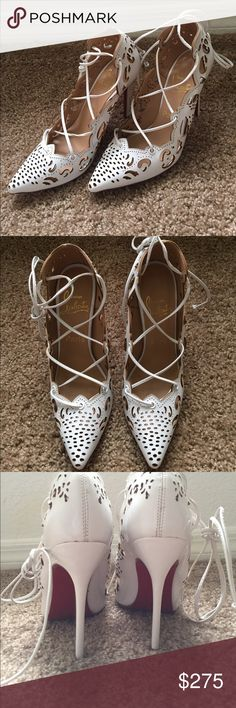 Christian Louboutin lace up strappy pumps White lace up strappy Louboutin heels. Never worn. Does not come with box or bag. Great condition. Was going to use them for my wedding but ended up getting something else. Size on shoe says 38 but fits a size 7. Christian Louboutin Shoes Heels