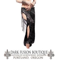 These narrow- legged pantaloons are made from stretchy black cotton with silver sequins. The sequin design looks almost like assuit :) Elastic