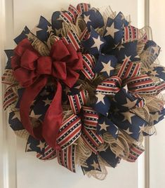 Display your patriotic side with the primitive wreath! Perfect decoration any time of the year. Made with burlap deco mesh, patriotic primitive ribbon and a burgundy bow. 19 inch, 22 inch and 25 inch availableBurlap deco mesh with denim and burlap r Patriotic Wreath, Patriotic Crafts, 4th Of July Wreath, Nautical Wreath, July Crafts, Wreath Crafts, Diy Wreath, Wreath Ideas, Tulle Wreath