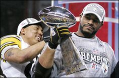 HInes Ward and Jerome Bettis with the Lombardi Trophy after the Steelers win their fifth Super Bowl over Seattle in Detroit (2006)