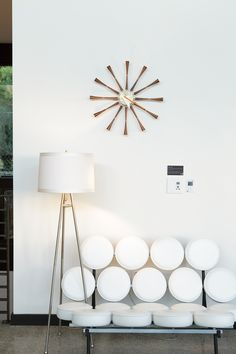 A vintage lamp and George Nelson's Marshmallow sofa and Spool clock embody the mid-century feel of Soheil and Nima Nakhshab's design for a California family home. Photo by: Ye Rin Mok