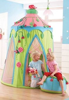 The Haba Rose Fairy tent is a free-standing play house that's easy to assemble and can fold down completely. It has plastic rods for support and is made of cotton, polyester and mesh. It is 210cm high and 150 cm in diameter. The rose garland adornments are included and it also features storage pockets #haba #playtent #Christmastoys