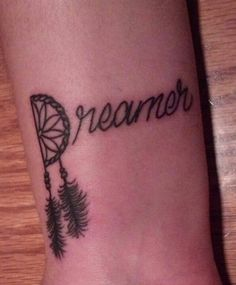 Newest tattoo... Dreamer. Never stop dreaming and let the dream catcher hold your dreams both good and bad <3
