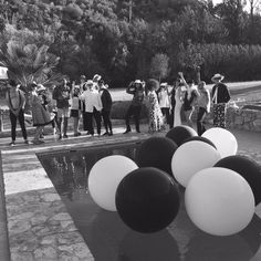 Giant black and white balloons for a birthday make a huge splash among the beautiful people at a pool party in the Spanish hills above Malaga Black And White Balloons, Black N White, Giant Balloons, Grad Parties, Malaga, 50th Birthday, Beautiful People, Spanish, Graduation