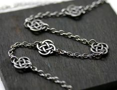 Celtic Knot Necklace in Antique Silver by robinhoodcouture on Etsy, $24.00