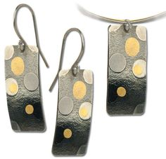 Keum-boo earrings and matching pendant...the link is an ad for a bead show...just pinned for inspiration :)