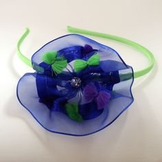 Hair Accessory:  Blue chiffon hairband with multicolored tufts and a crystal embellishment by OmaDesigns on Etsy