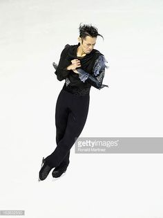Daisuke Takahashi of Japan competes in the Men's Short Program during the 2013 ISU World Figure Skating Championships at Budweiser Gardens on March...