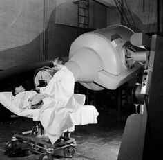 1955: A rotating cobalt machine swinging around the body of a patient, attacking cancerous tumors. | www.eklectica.in