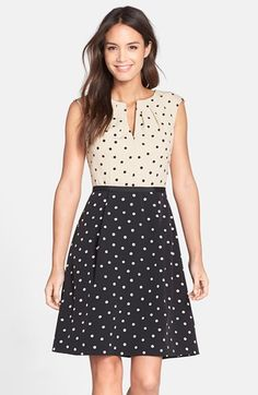 Adrianna Papell Dot Crepe Fit & Flare Dress | A dot-spangled cap-sleeve dress is divided by an inverted palette and waist-accentuating ribbon trim. Crisp pleats frame the split neckline and volumize the flared skirt.