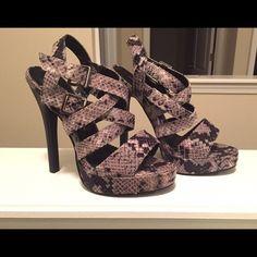 Snake skin pattern sandals. 5inch snake skin shoes.  Never been worn. Newport News Shoes Heels