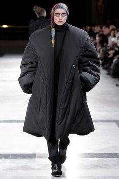 Black oversized down coat with shawl collar by Yohji Yamamoto. #IStyleNY #Style